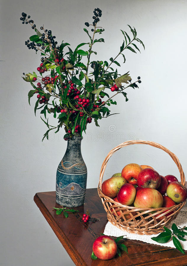 Autumn still life. With apple and flowers stock photography