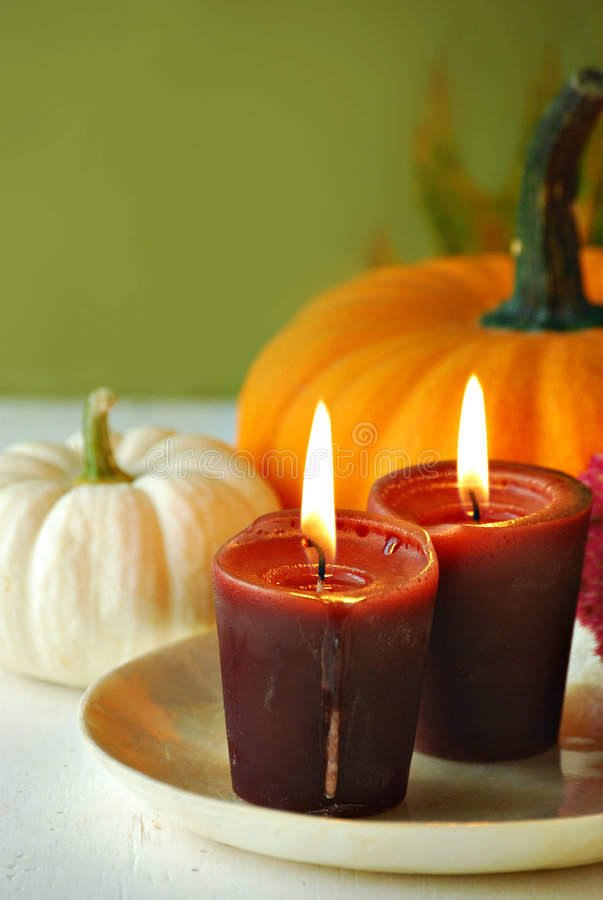 Autumn still life. Pumpkins and gourds with candles stock images