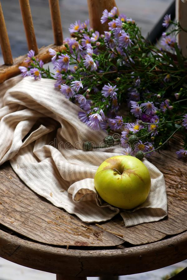 Autumn still life with apples and flowers stock photo
