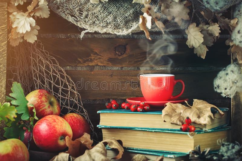 Autumn still life with a cup of coffee, apples and autumn leaves. Autumn background. royalty free stock photography