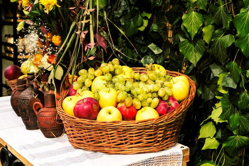 Autumn still life of fruit in a basket and a jug of wine stock photos
