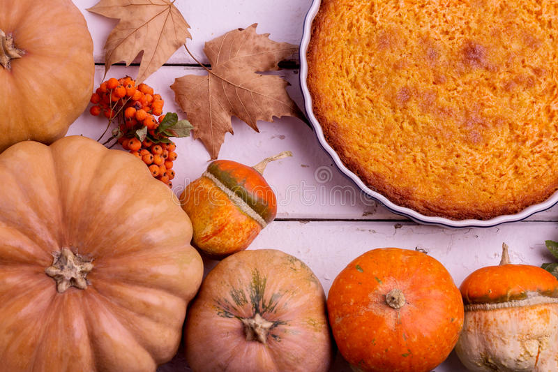 Autumn still life. Homemade Pumpkin Pie for Thanksgiving Day. stock photography
