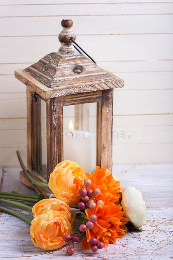 Autumn still life photo with flowers in yellow colors and candl royalty free stock image