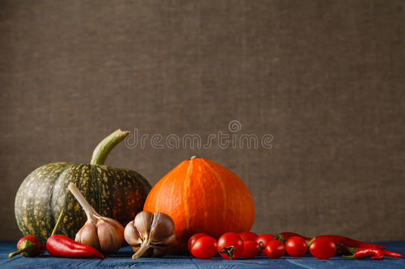 Autumn still life with pumpkins and leaves on old wooden background stock photography