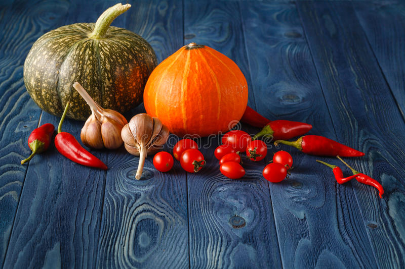 Autumn still life with pumpkins on old wooden backgro royalty free stock images