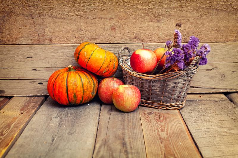 Autumn still life with pumpkins on a wooden table royalty free stock image