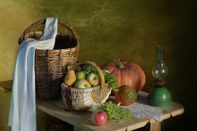 Still life with autumn leaves, cranberries and fruits royalty free stock photo
