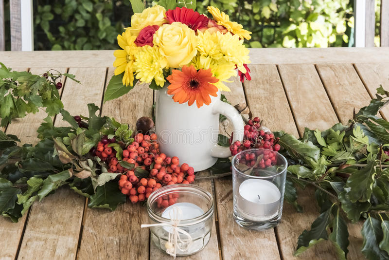 Autumn Still Life. Table with autumn flowers and candles stock images