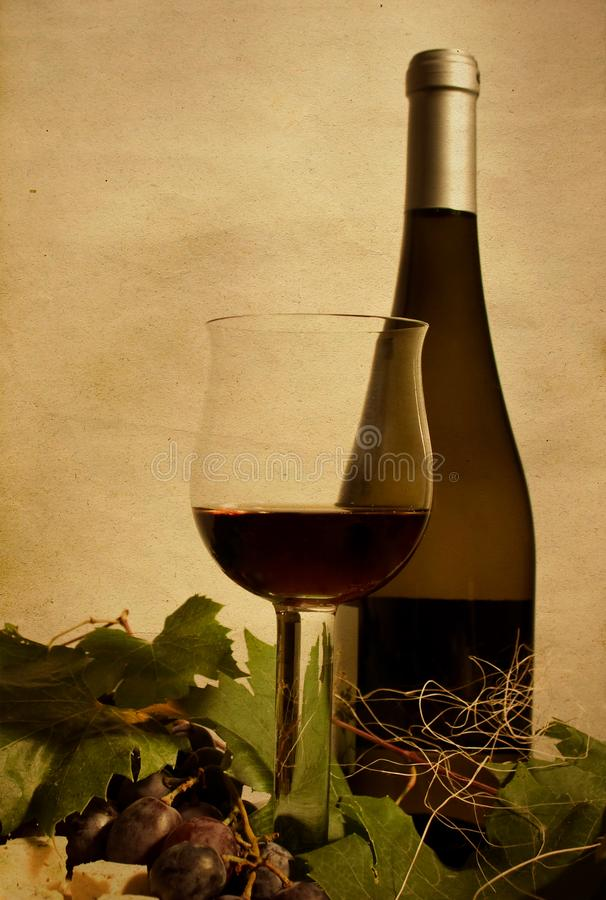 Autumn still life with wine and grapes royalty free stock image