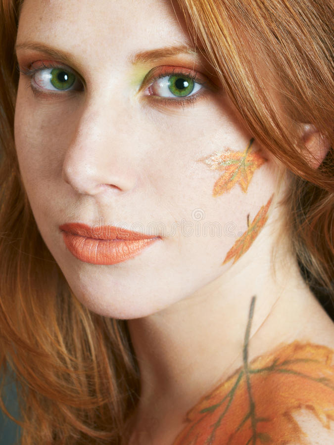 Autumn style face-art. Beautiful girl with autumn style face-art make-up stock photos