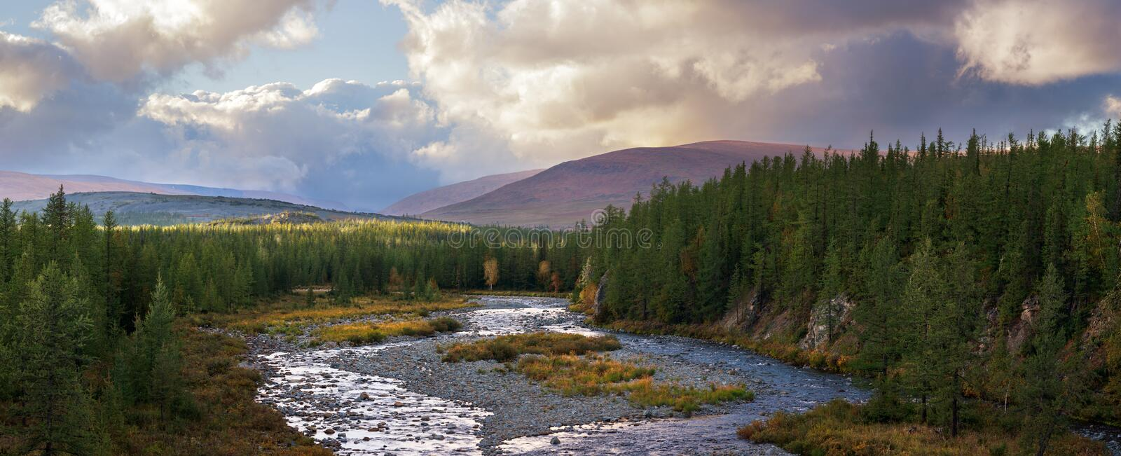 Autumn summer seasons mountain forest river clouds landscape banners long panorama wild nature. Autumn summer seasons mountain forest river clouds landscape for stock photos
