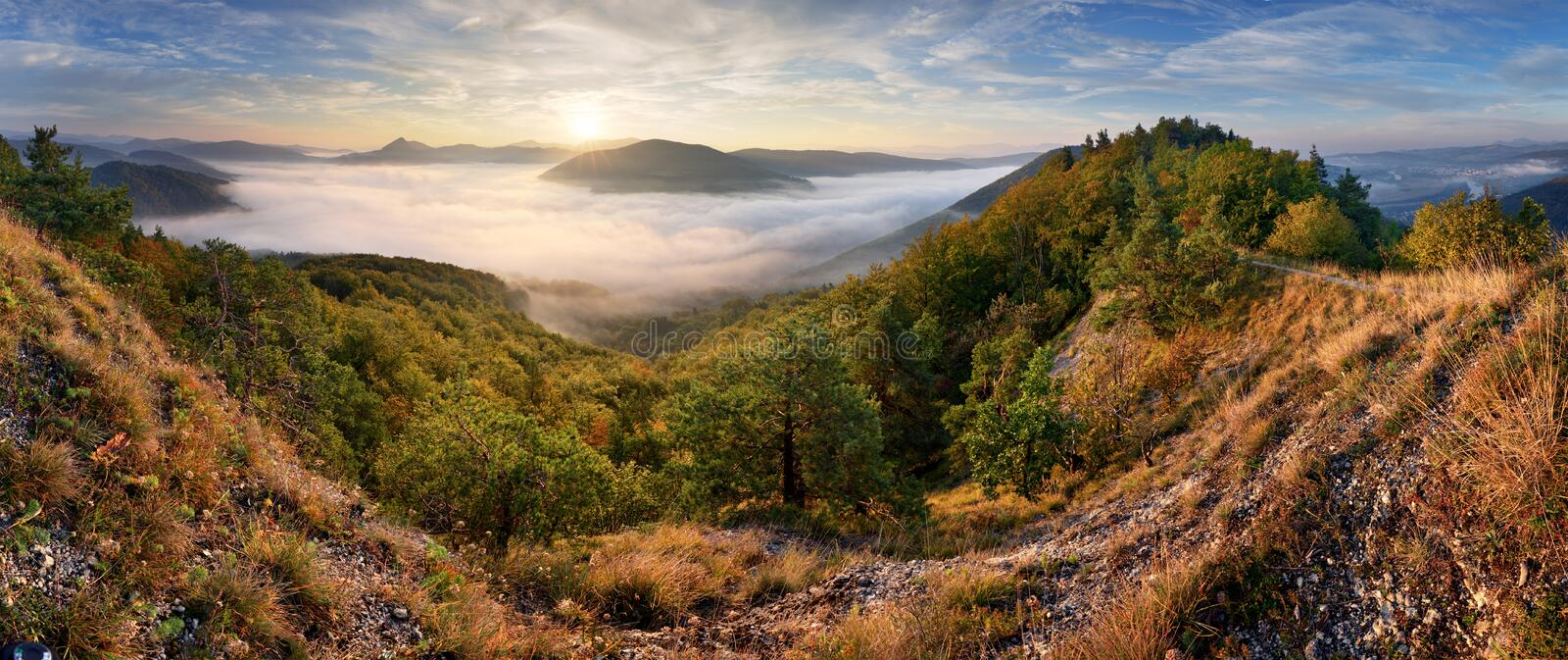 Autumn sunrise above mist and forest landscape, Slovakia, Nosice royalty free stock photo