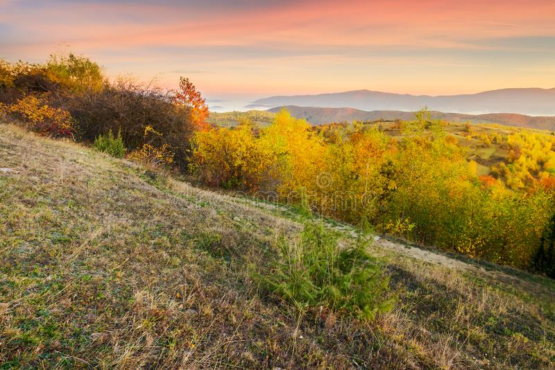 Autumn sunrise in mountains stock images