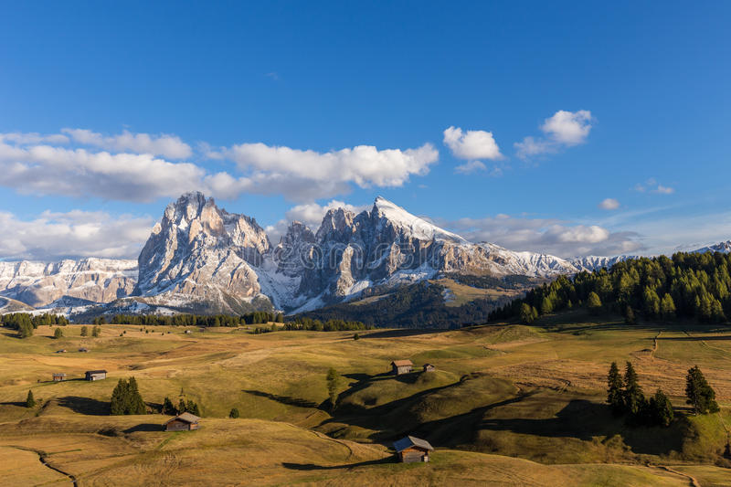Autumn sunset at Alpe de Suisi with view at Sassolungo in Italy royalty free stock image