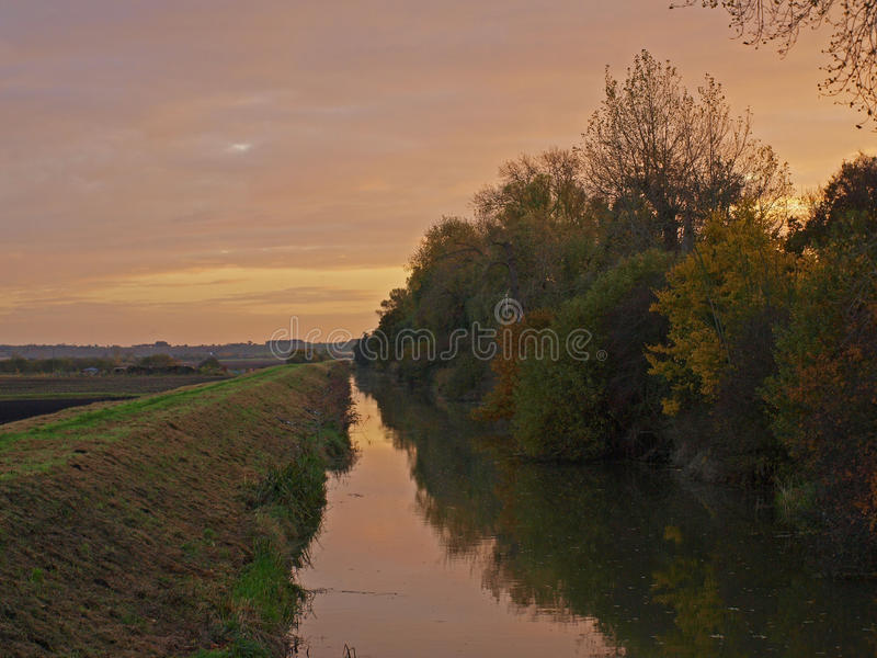 Autumn sunset on the Great Fen Project. Photo taken on an autumn day at sunset of the bridge over Great Raveley Drain, at the entrance to Woodwalton fen royalty free stock photography