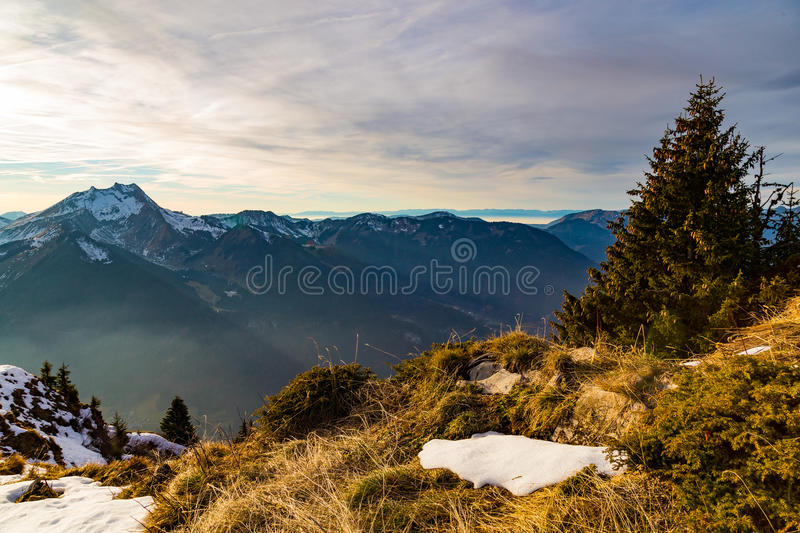 Autumn sunset over a grassy mountain side royalty free stock image