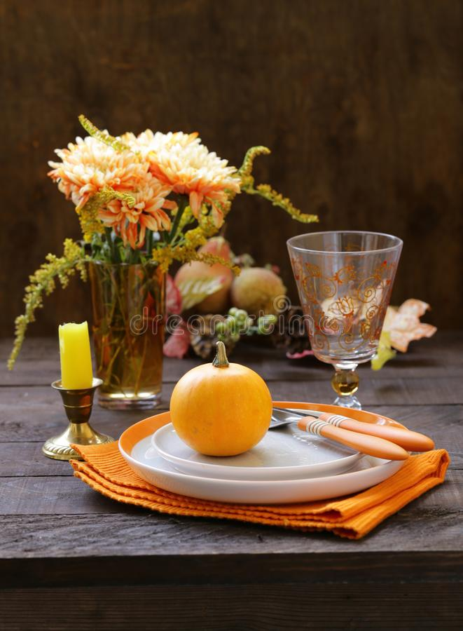 Autumn table setting. With pumpkin and flowers stock photography