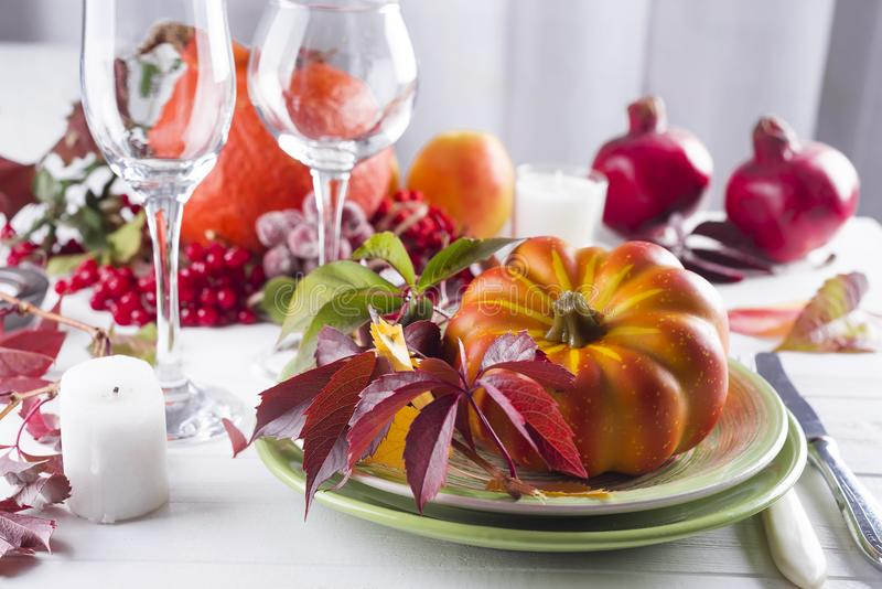 Autumn table setting with pumpkins. royalty free stock photo
