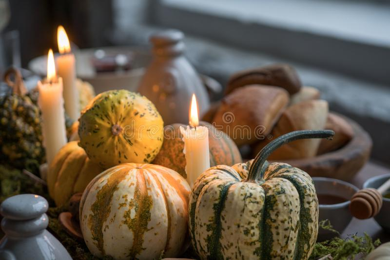 Autumn table setting with pumpkins. Thanksgiving dinner and fall decoration. stock photography