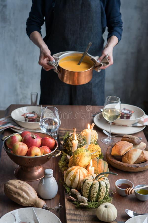 Autumn table setting with pumpkins. Thanksgiving dinner and fall decoration. royalty free stock photo