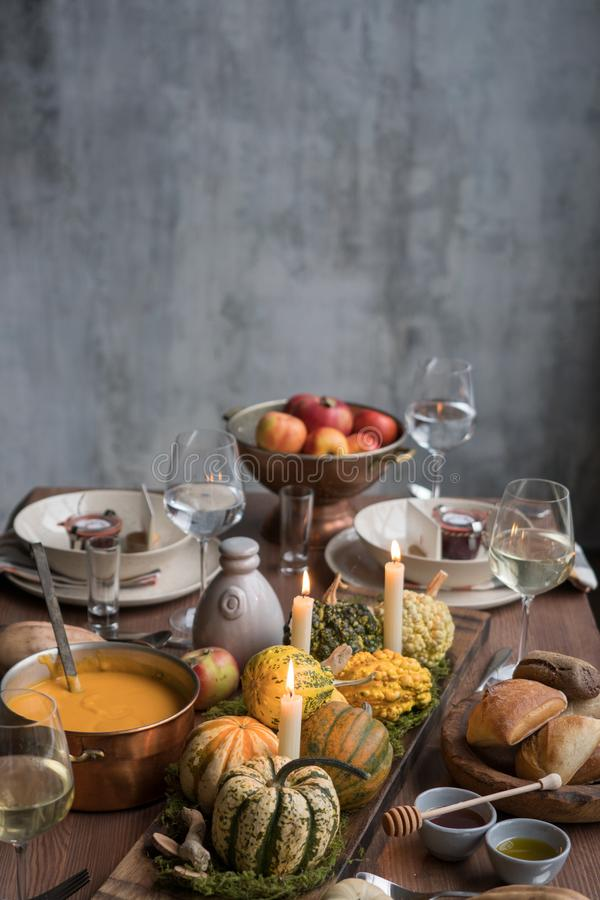 Autumn table setting with pumpkins. Thanksgiving dinner and fall decoration. stock photos