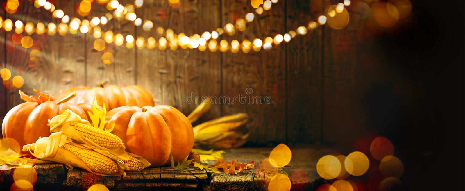 Autumn Thanksgiving pumpkins over wooden background stock photo