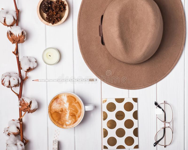 Autumn themed flat ly with felt hat and coffee royalty free stock image