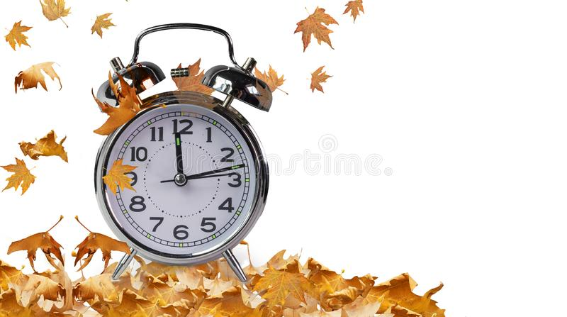 Autumn time clock and leaves isolated for background royalty free stock photos