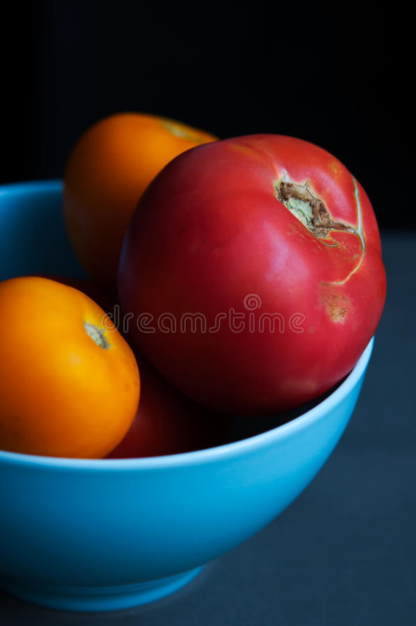 Download Autumn Tomatoes In Blue Bowl Stock Photo - Image: 33456912