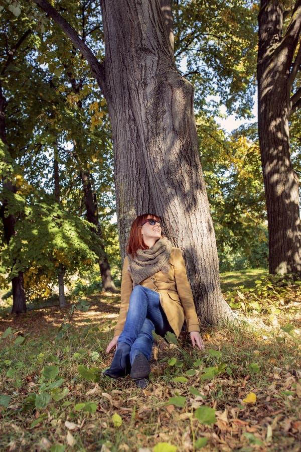 Autumn trees, fall season. Fun in the autumn forest. Smiling girl enjoying in nature stock photos
