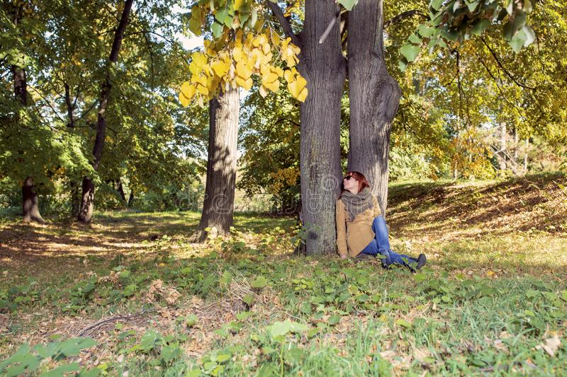 Autumn trees, fall season. Fun in the autumn forest. Smiling girl enjoying in nature stock image