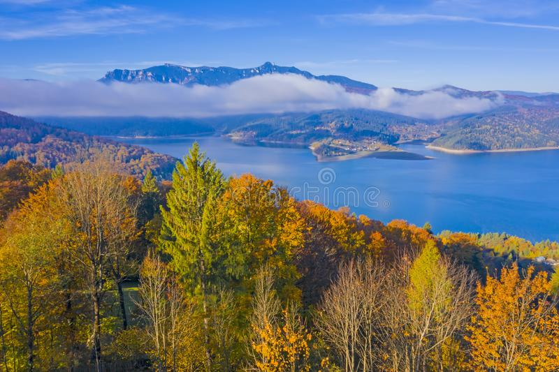 Autumn trees and mountain lake scene stock photos