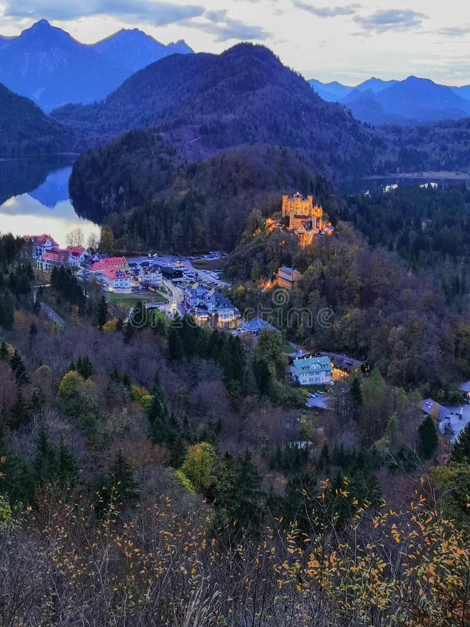 Autumn twilight view over Hohenschwangau castle tall royalty free stock images