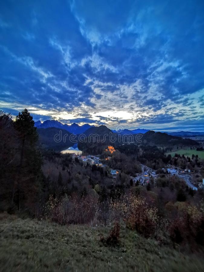 Autumn twilight view over Hohenschwangau castle tall royalty free stock photography