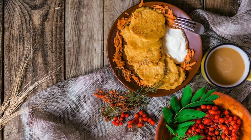 Autumn vegetable fritters with carrots royalty free stock photo