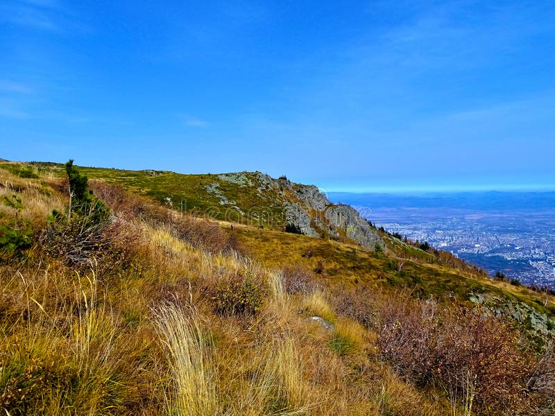 Autumn veiw from Vitosha Mountain in a warm October day. The Mountain meets the sky royalty free stock photography