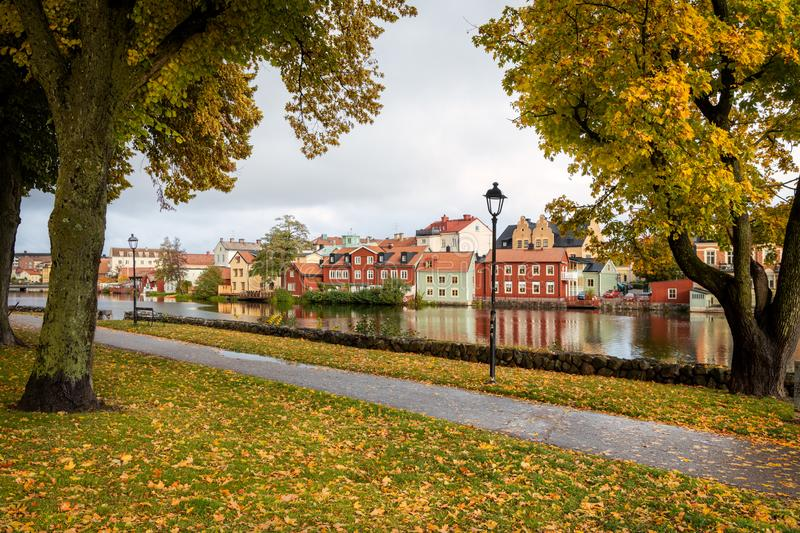 Autumn view in Eskilstuna, Sweden. Autumn view of Eskilstuna old town seen from the other side of river through trees royalty free stock photography