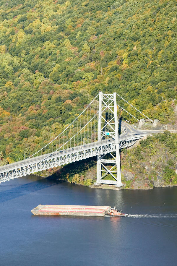 Autumn view overlook of Bear Mountain Bridge, trash barge and Hudson Valley and River at Bear Mountain State Park, New York royalty free stock photography