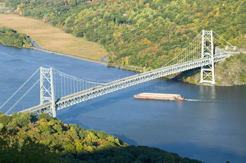 Autumn view overlook of Bear Mountain Bridge, trash barge and Hudson Valley and River at Bear Mountain State Park, New York stock photos