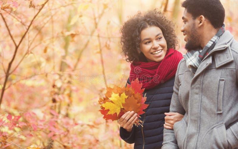 Autumn walk. Happy couple enjoying weekend in park stock images
