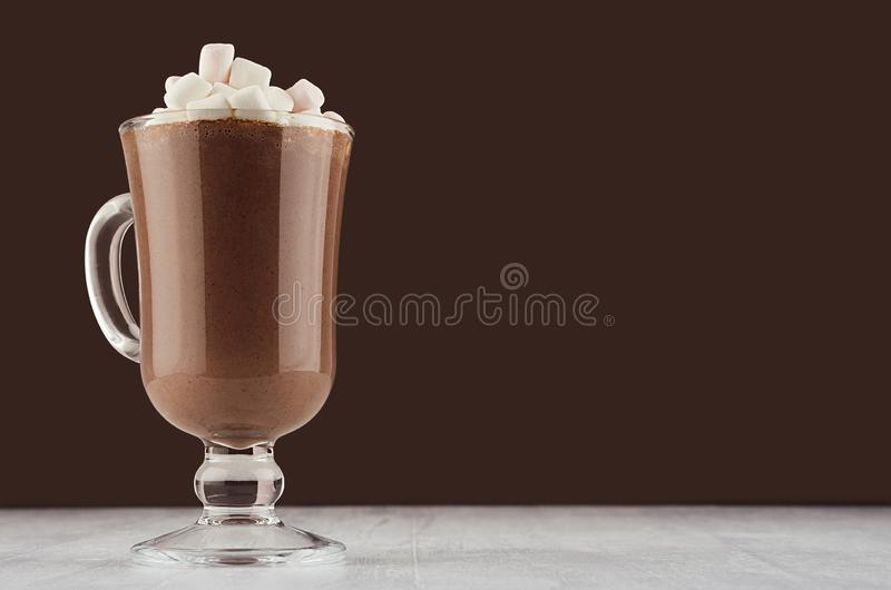 Autumn warm drink - hot cocoa with marshmallows on dark brown background, copy space. Autumn warm drink - hot cocoa with marshmallows  on dark brown background stock image