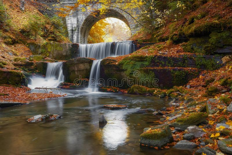 Autumn waterfalls near Sitovo, Plovdiv, Bulgaria. Beautiful cascades of water with fallen yellow leaves. Autumn waterfalls near Sitovo, Plovdiv, Bulgaria stock photos