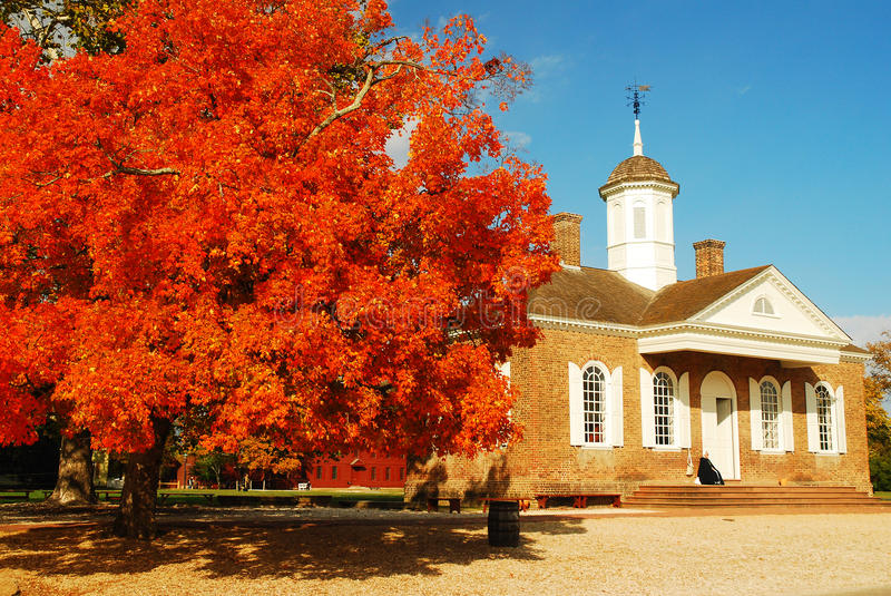 Autumn at Williamsburg. Fall colors explode in front of the colonial era Williamsburg Courthouse royalty free stock photography