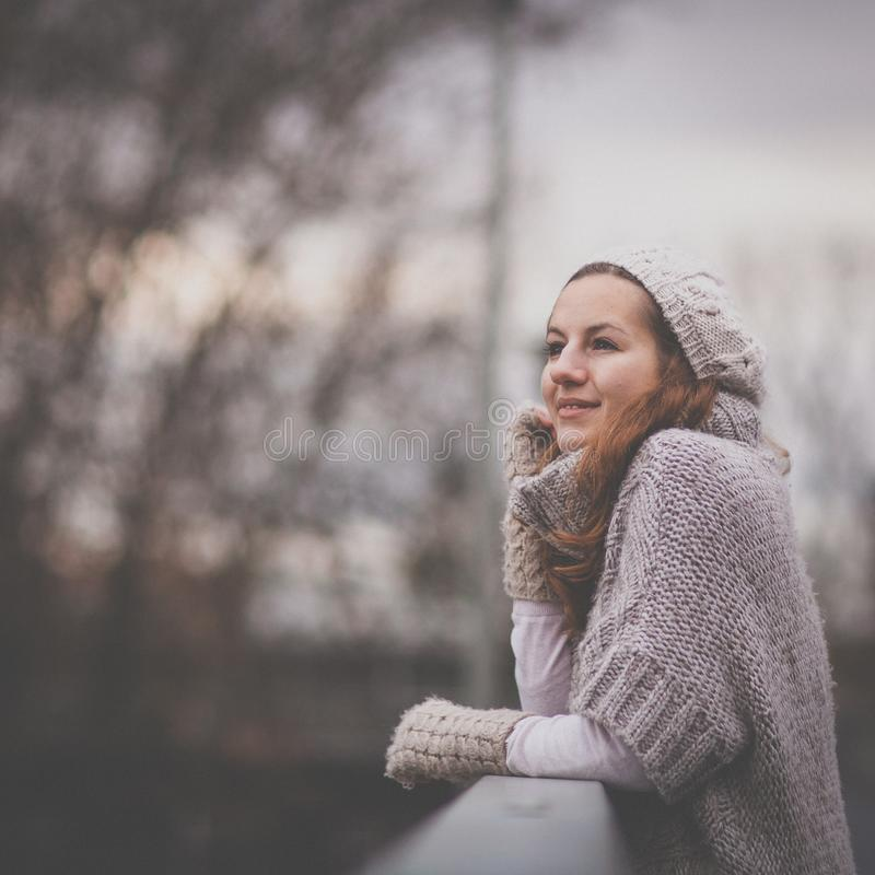 Autumn/winter portrait: young woman dressed in a warm woolen cardigan royalty free stock photo