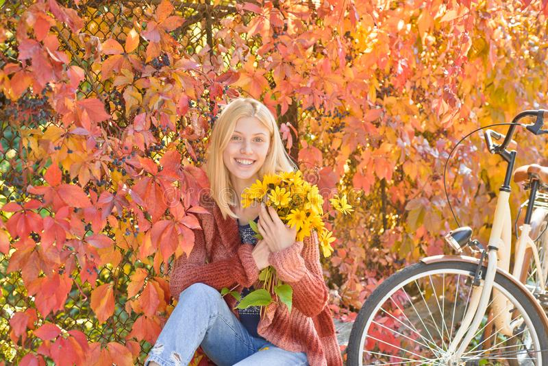 Autumn Woman with Autumn Leaves on Beautiful Fall Nature Background. Outdoor atmospheric fashion photo of young royalty free stock image