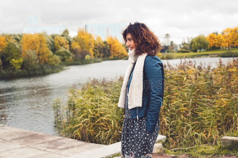 Autumn woman in black jacket and knitted scarf royalty free stock images