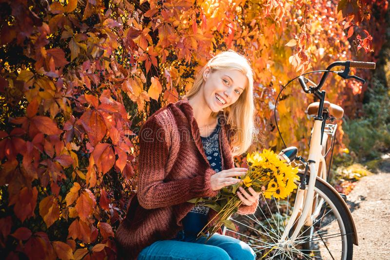 Autumn woman. Carefree young woman in trendy vintage pullover or sweater. Outdoors lifestyle fashion portrait of pretty. Young woman walking on the autumn park stock image