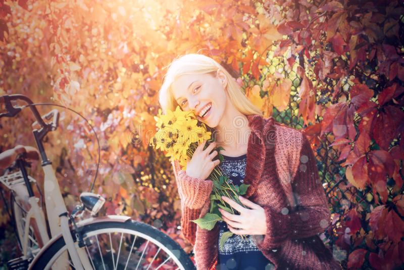 Autumn woman. Dreamy girl with blonde hair in knit sweater. Enjoying good weather. Fall concept. Autumn woman. Dreamy girl with blonde hair in knit sweater royalty free stock images