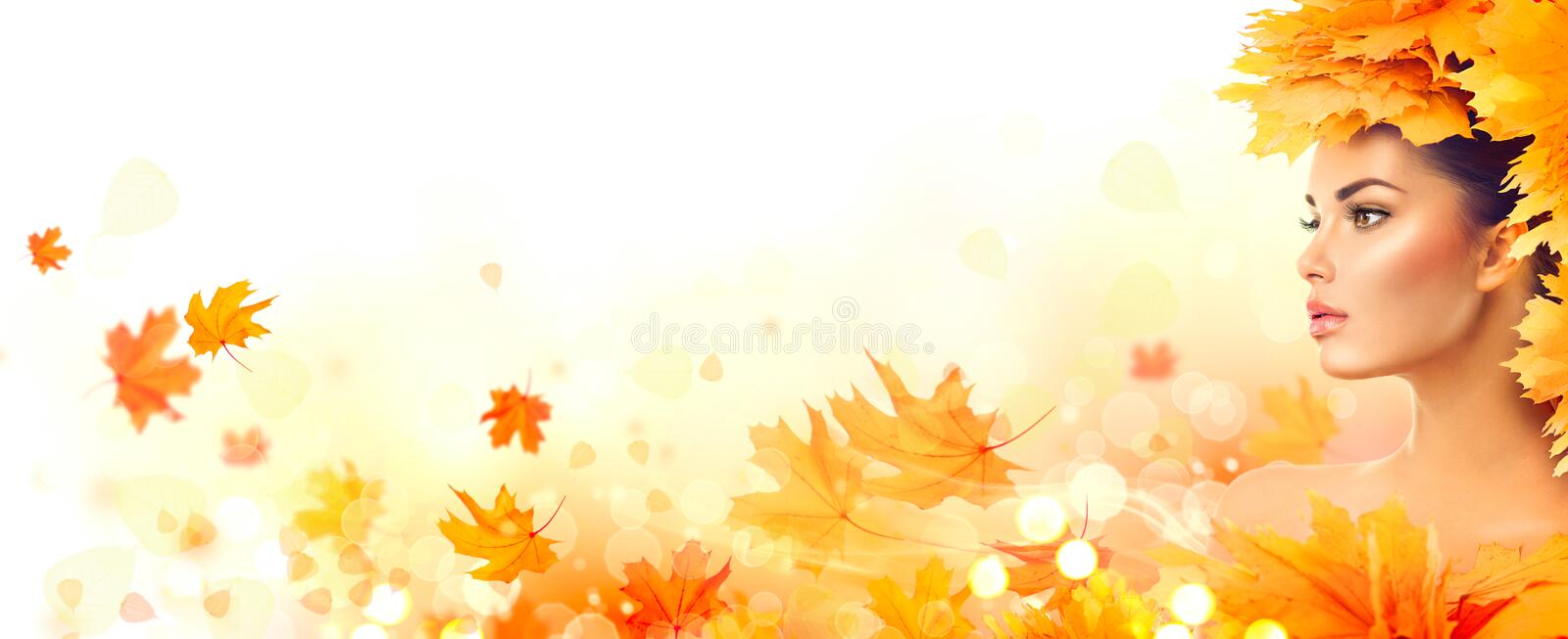Autumn woman. Fall. Beauty model girl with autumn bright leaves. Hairstyle royalty free stock photography