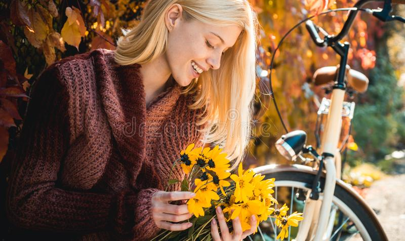 Autumn woman. Happy girl on autumn walk. Carefree young woman in trendy vintage pullover or sweater. Dreamy girl with. Blonde hair in knit sweater. Hello Autumn stock photo